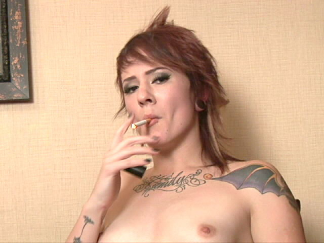 Inked Crimson Haired Nubile Sailor Smoking With Zeal At The Digital Camera